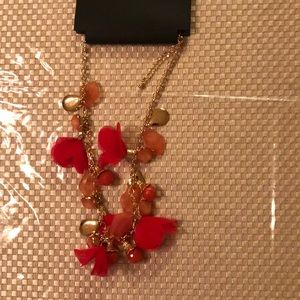 Beautiful necklace hanging with pink flowers 🌺